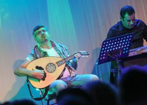 Local musicians playing the Oud and the Qanun